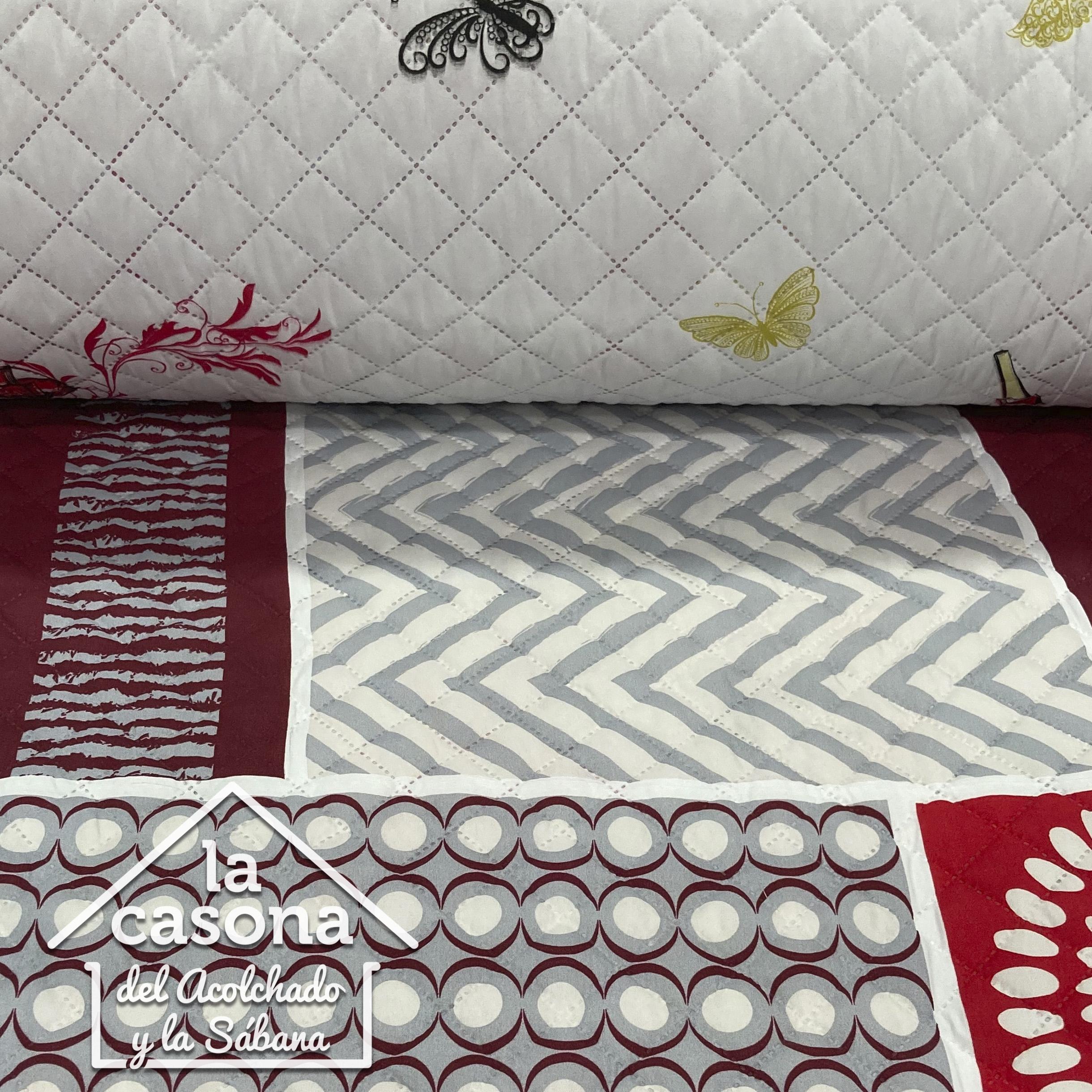 enfoque tela acolchada doble faz diseño de puntos, rayas y circulos en rojo y gris