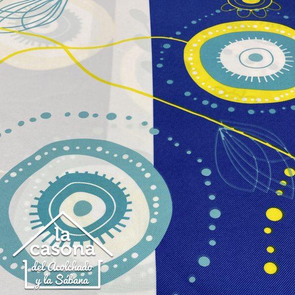 enfoque tela polialgodón con diseños de circulos en color azul y amarillo