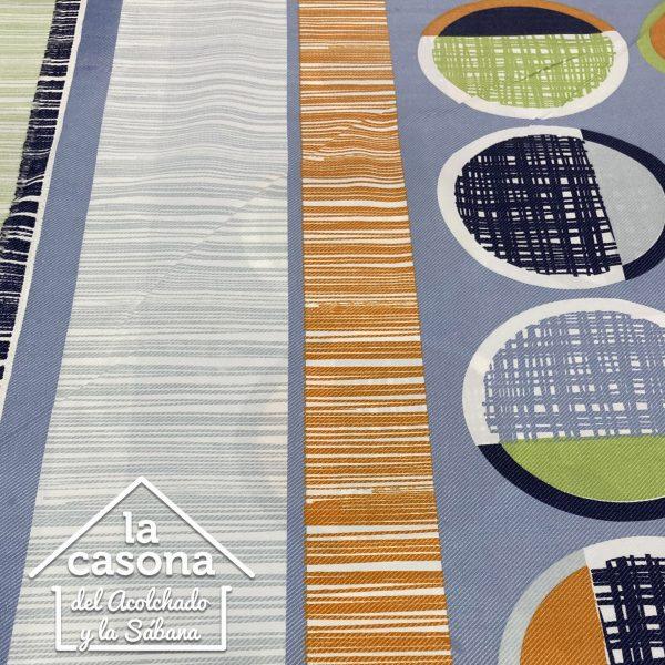 enfoque tela polialgodón con diseños de dibujos a rayas en color morado y naranja