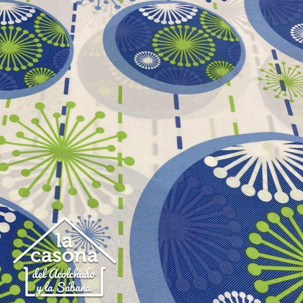 enfoque tela polialgodón con diseños de figuras con circulos en las puntas en azul, verde y blanco