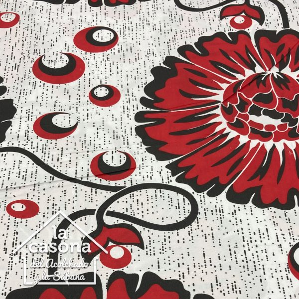 enfoque tela polialgodon con diseños de flores y circulos en rojo y negro