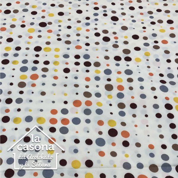 enfoque tela polialgodon con diseños de puntos en diferentes colores y tamaños