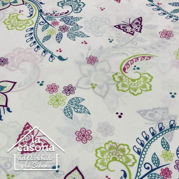 enfoque tela polialgodon con diseños florales en rosa, verde y azul