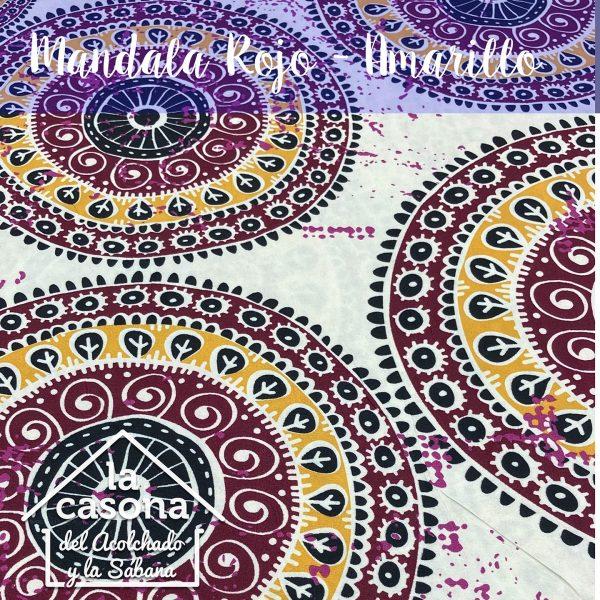 enfoque-tela-polialgodón-con-diseños-de-mandalas-en-colores-calidos-con-toques-lila