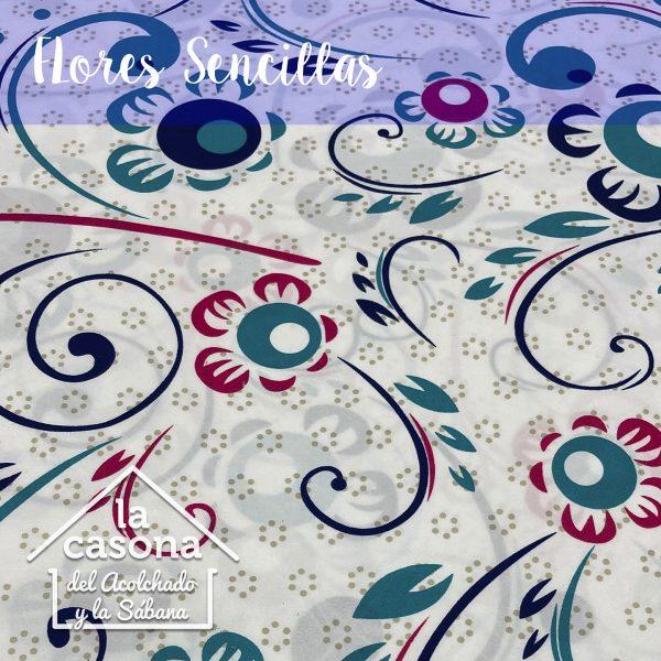 enfoque-tela-polialgodon-con-diseños-de-flores-en-tonos-rosa-y-agua-marina